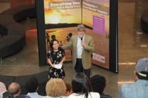"Peace work- Dwight-Englewood Upper School senior Erika Ogino and Principal Joseph Algrant at the opening of ""Everything you Treasure,"" Englewood, N.J., April 24. Photo: Kevin Lyden"