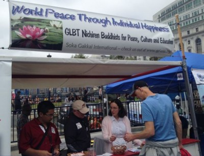 Managing a booth introducing passersby to Nichiren Buddhism during a Pride event in San Francisco