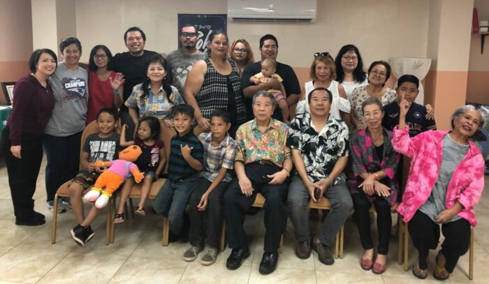 (Bottom) Peter Patrick Salas with members of Yigo District at the SGI- USA center in Tamuning, Guam, January 2020. With the COVID-19 pandemic, they transitioned to meeting virtually without ever losing sight of their mission for kosen-rufu. Photo by Nancy Gorris