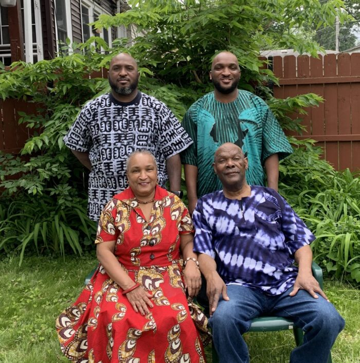 Alice Quaye with her family (l-r), sons, Lonnie and NiiAyi, and husband, Samuel (bottom right). (Inset) Alice as a police officer in 1983.