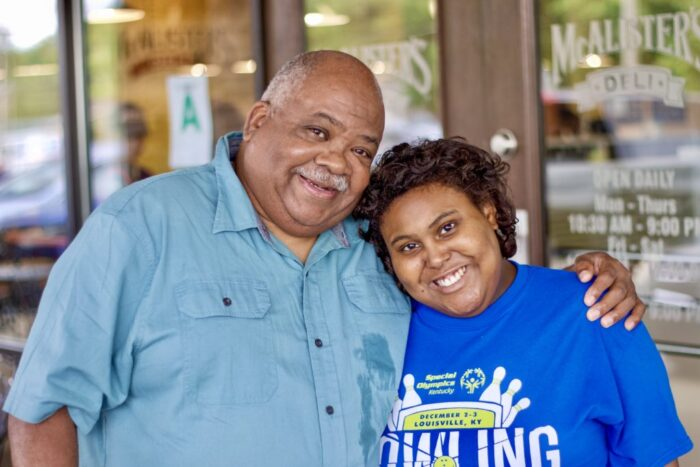 George Campbell (left) with his daughter, Jamesha Maddox, in front of the restaurant where she works, Louisville, Ky., July 2021. Photo by Desmond Thomkins