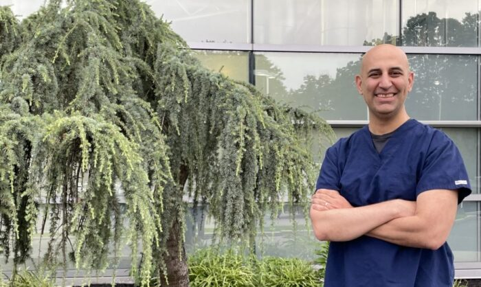 Bora Colak in front of his workplace, Long Island, N.Y., August 2021.